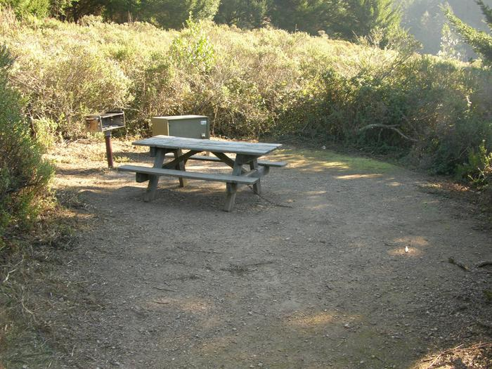 Campsite with picnic table, food storage locker, and charcoal grill.Sky 9