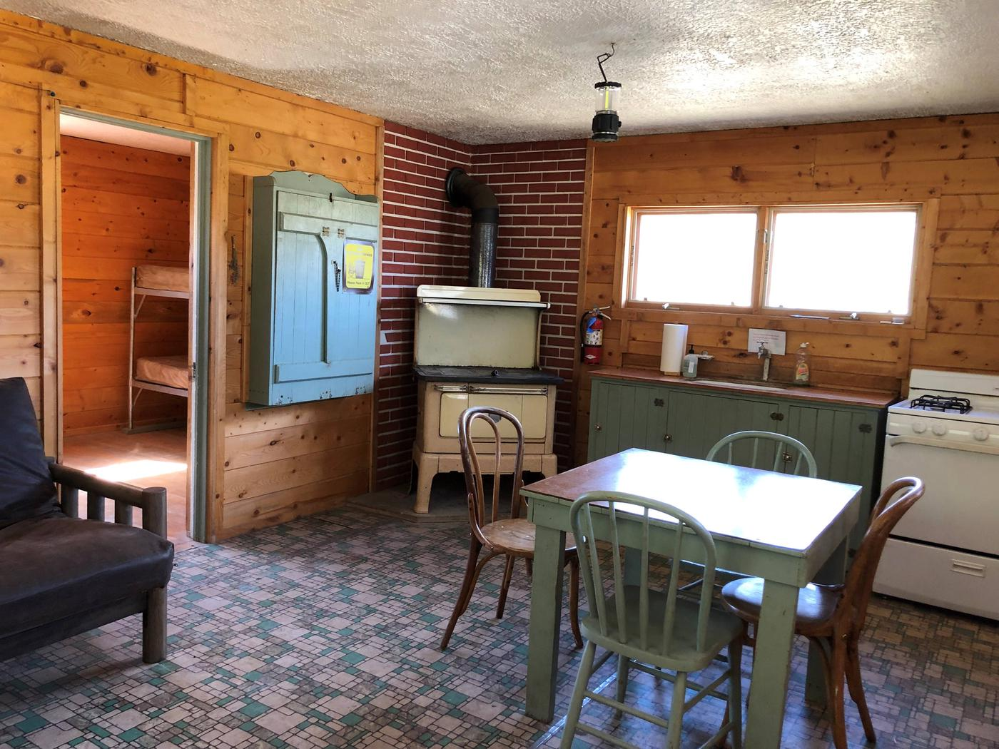 Woodstove, table and chairs, gas range and sinkFront Room of Cabin