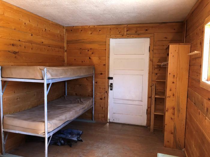 Bunkbeds, shelves and backdoorBackroom