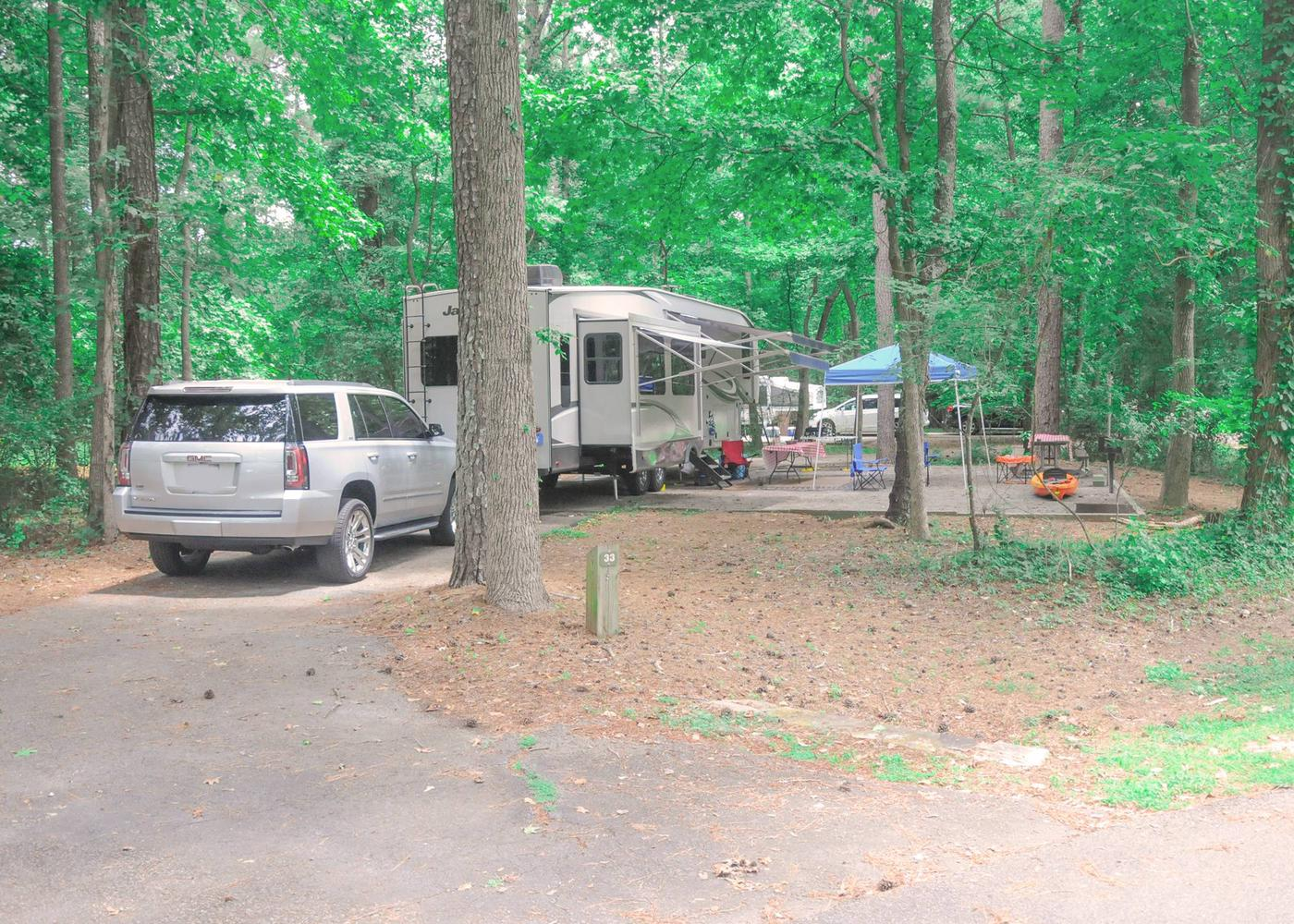 Pull-thru entrance, driveway slope, awning-side clearance.Victoria Campground, campsite 32.