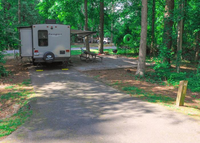 Pull-thru entrance, driveway slope, awning-side clearance, utilities-side clearance.Victoria Campground, campsite 38.