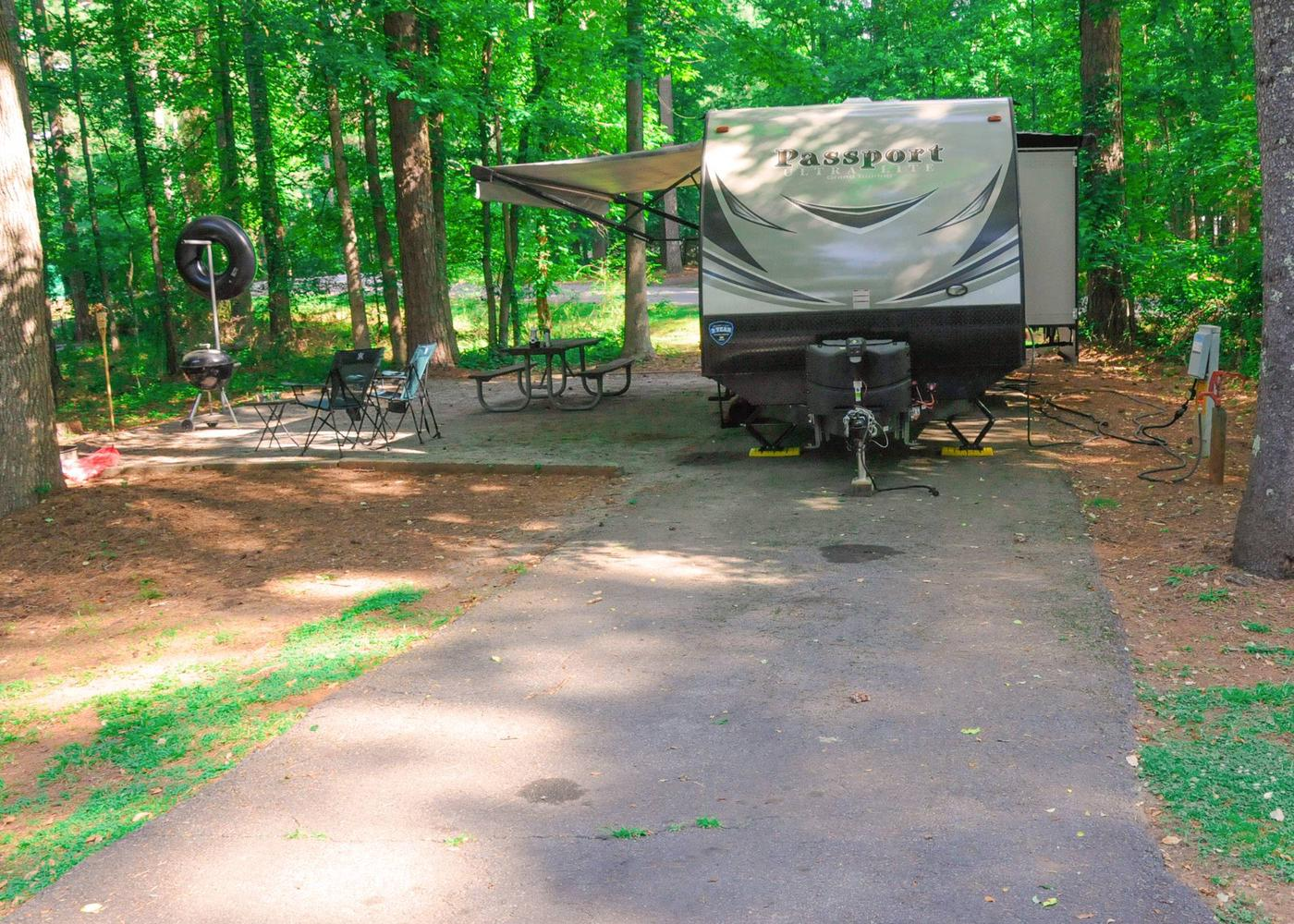 Pull-thru exit, driveway slope, awning-side clearance.Victoria Campground, campsite 38.