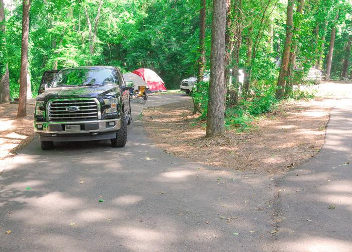 Pull-thru exit, driveway slope, utilities-side clearance.Victoria Campground, campsite 48.