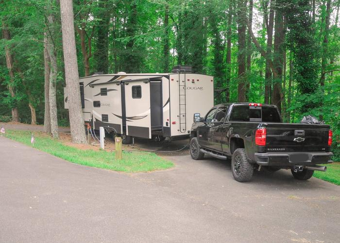 Pull-thru entrance, utilities clearance.Victoria Campground, campsite 54.