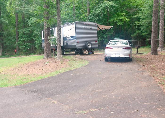 Pull-thru entrance, driveway slope, awning-side clearance, utilities-side clearance.Victoria Campground, campsite 60.