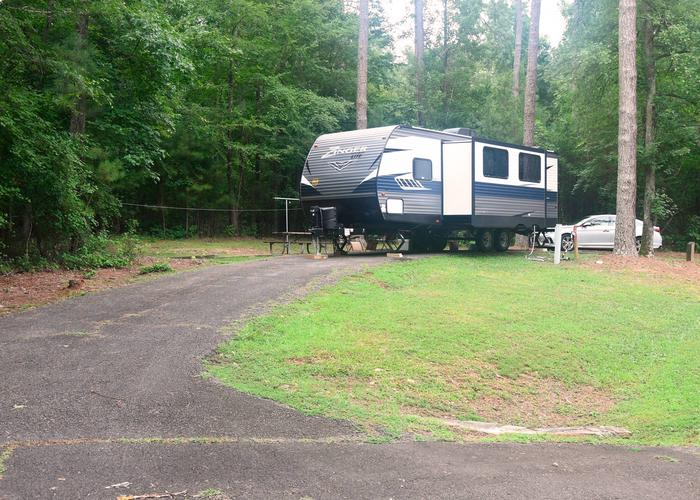 Pull-thru exit, driveway slope, utilities-side clearance.Victoria Campground, campsite 60.