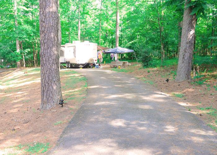 Pull-thru entrance, driveway slope, awning-side clearance, utilities-side clearance.Victoria Campground, campsite 62.