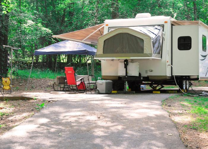 Pull-thru exit, driveway slope, awning-side clearance, campsite view.Victoria Campground, campsite 62.