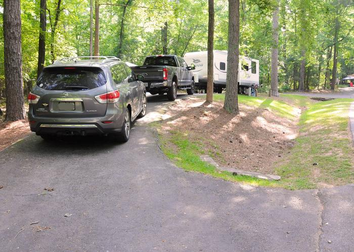 Pull-thru exit, driveway slope, utilities-side clearance.Victoria Campground, campsite 63.