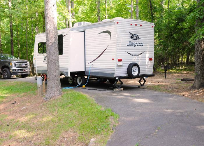 Pull-thru entrance, driveway slope, utilities-side clearance.Victoria Campground, campsite 63.