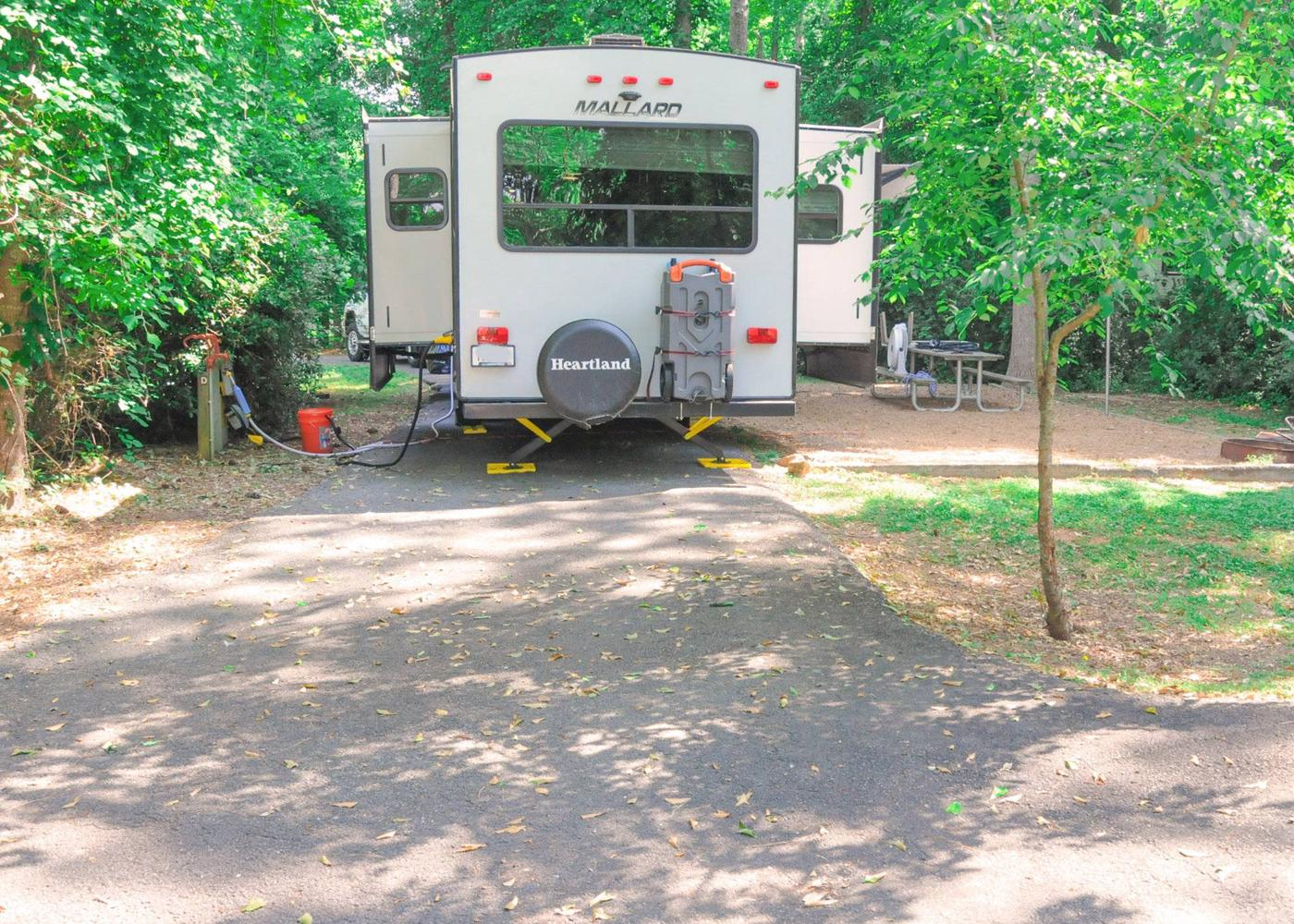 Pull-thru entrance, driveway slope, awning-side clearance, utilities-side clearance.Victoria Campground, campsite 69.