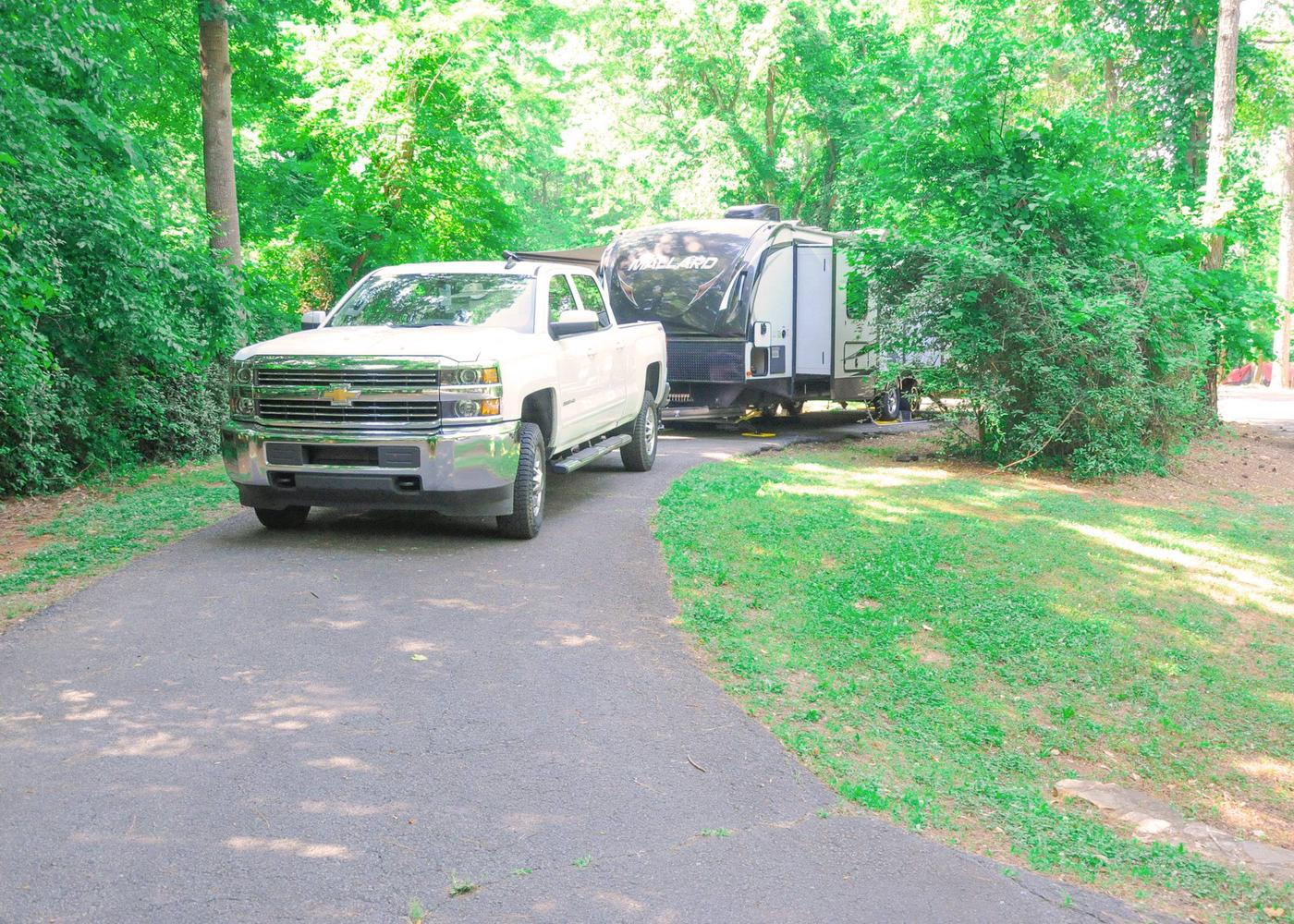 Pull-thru exit, driveway slope, utilities-side clearance.Victoria Campground, campsite 69.