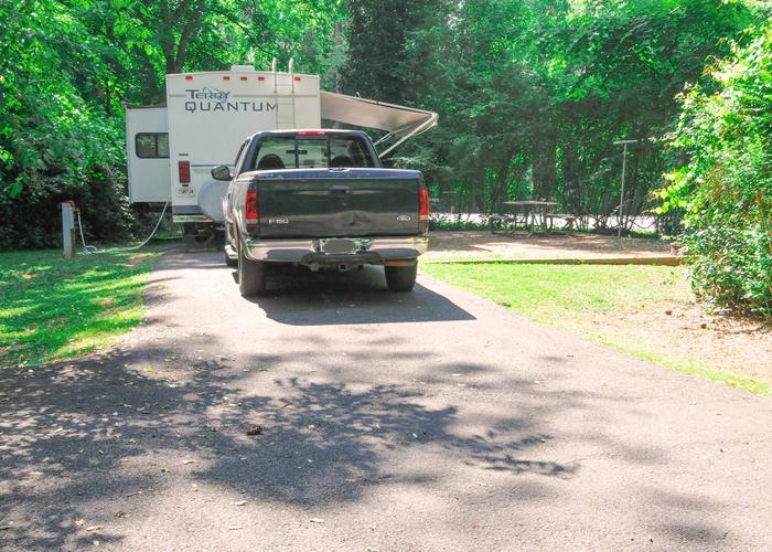 Pull-thru entrance, driveway slope, awning-side clearance, utilities-side clearance.Victoria Campground, campsite 70.