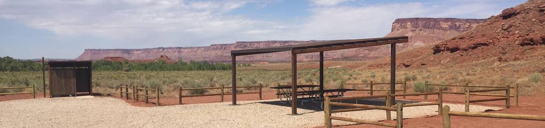 Superbowl Group SiteSuperbowl group site with red sandstone cliffs in background