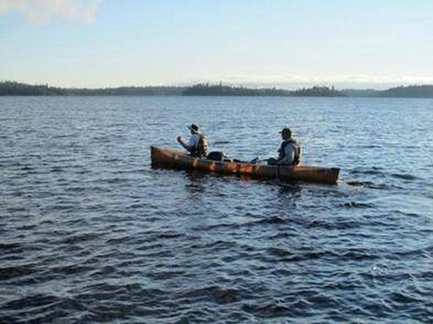 people on canoe in lake