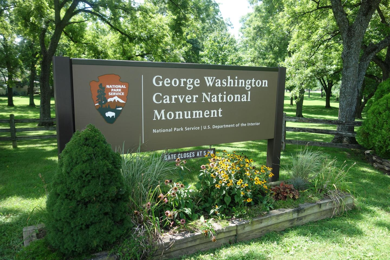George Washington Carver NM EntranceEntrance sign to George Washington Carver NM will wildflower and plants.
