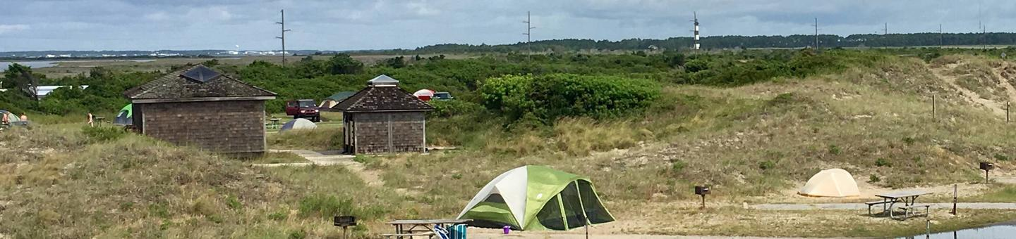 A view of Oregon Inlet Campground overlooking the Bodie Island LightouseThe tent only loop at Oregon Inlet Campground with the Bodie Island Lighthouse in the background