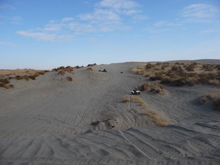 Riding a dune at Juniper Dunes OHV Area