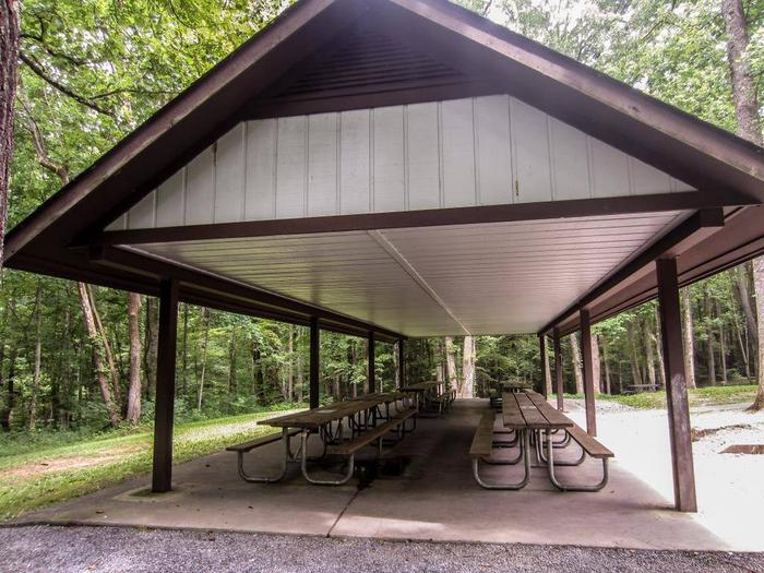 Sheltered tablesLarge covered pavilion with serving table