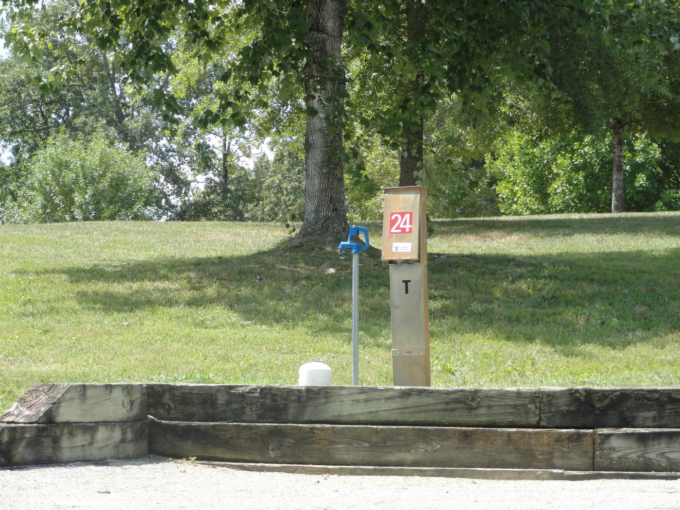 WILLOW GROVE CAMPGROUND SITE #24 PEDESTAL AND WATERWILLOW GROVE CAMPGROUND SITE #24 WHITE CAP IS WATER VALVE, NOT SEWER