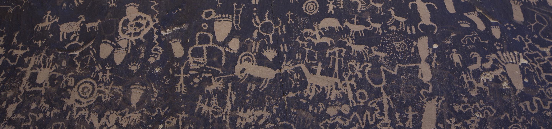 Petroglyphs at Newspaper RockView of petroglyphs on dark rocks