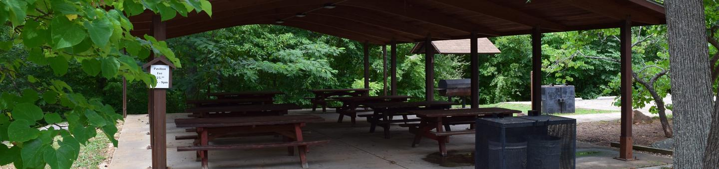 Showing shelter, picnic tables,grill and trash receptacle.Group shelter