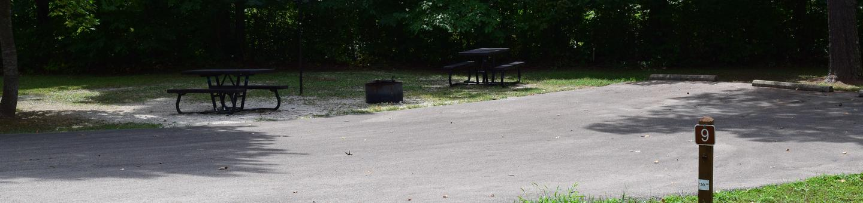 Double campsite 9 showing double parking, picnic tables, lantern post and fire ringDouble campsite 9