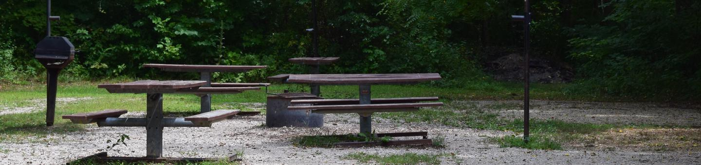 Group campsite 15 showing picnic tables, lantern post and fire ringGroup campsite 15