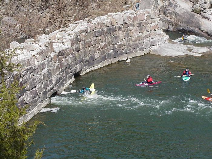 Kayakers Playing Around Old Minig Company DamKayakers Playing in River by Old Dam
