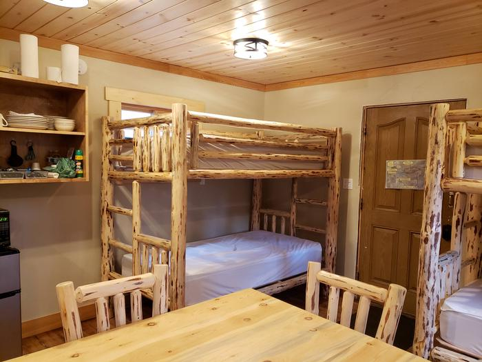 View of dining table and 2 sets of bunk bedsDining Table and Bunk Beds