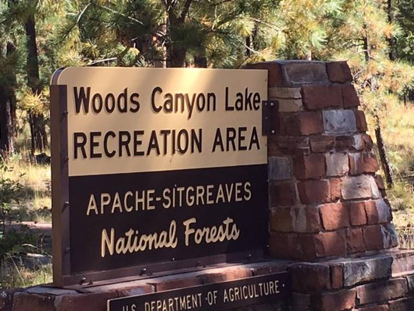 Woods Canyon Lake Recreation Area Portal SignCrook Group Campground is located less than a mile from Woods Canyon Lake. The paved Meadow Trail guides visitors from the campground to the lake.
