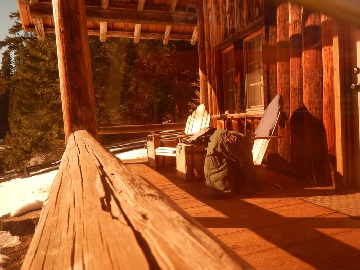 Hall House Cabin front porchHall House Cabin porch bathed in evening light