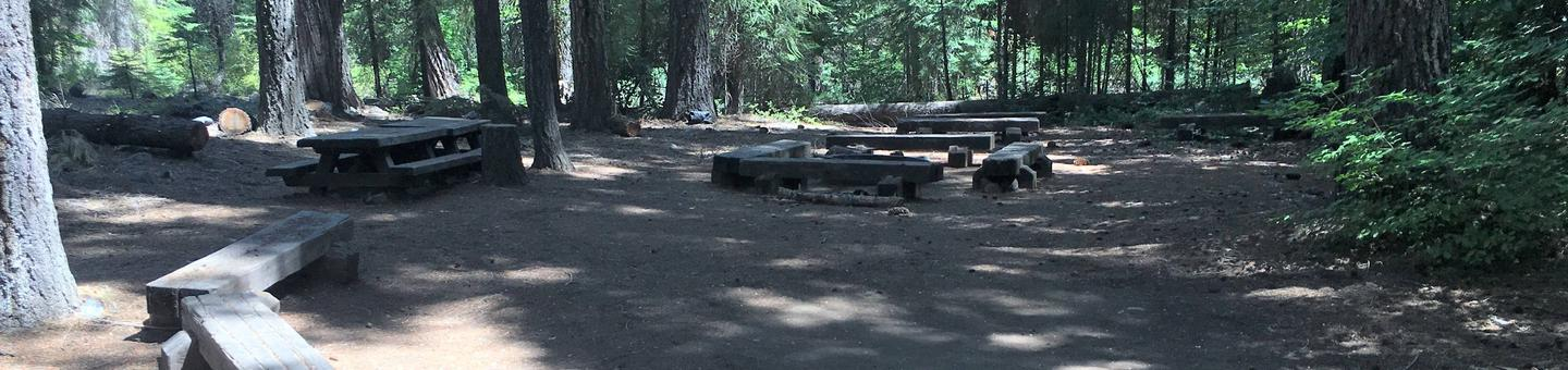 Lush forest provide shade for Middle Meadows Group CampgroundGroup campfire ring for Unit 2