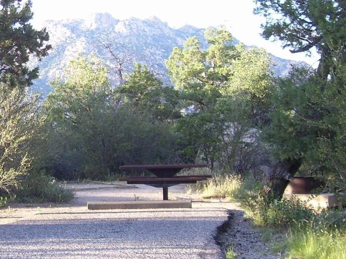 Site #15 shaded parking, picnic table, grill on the right and Granite Mountain in the backgroundSite #15 Facing Granite Mountain