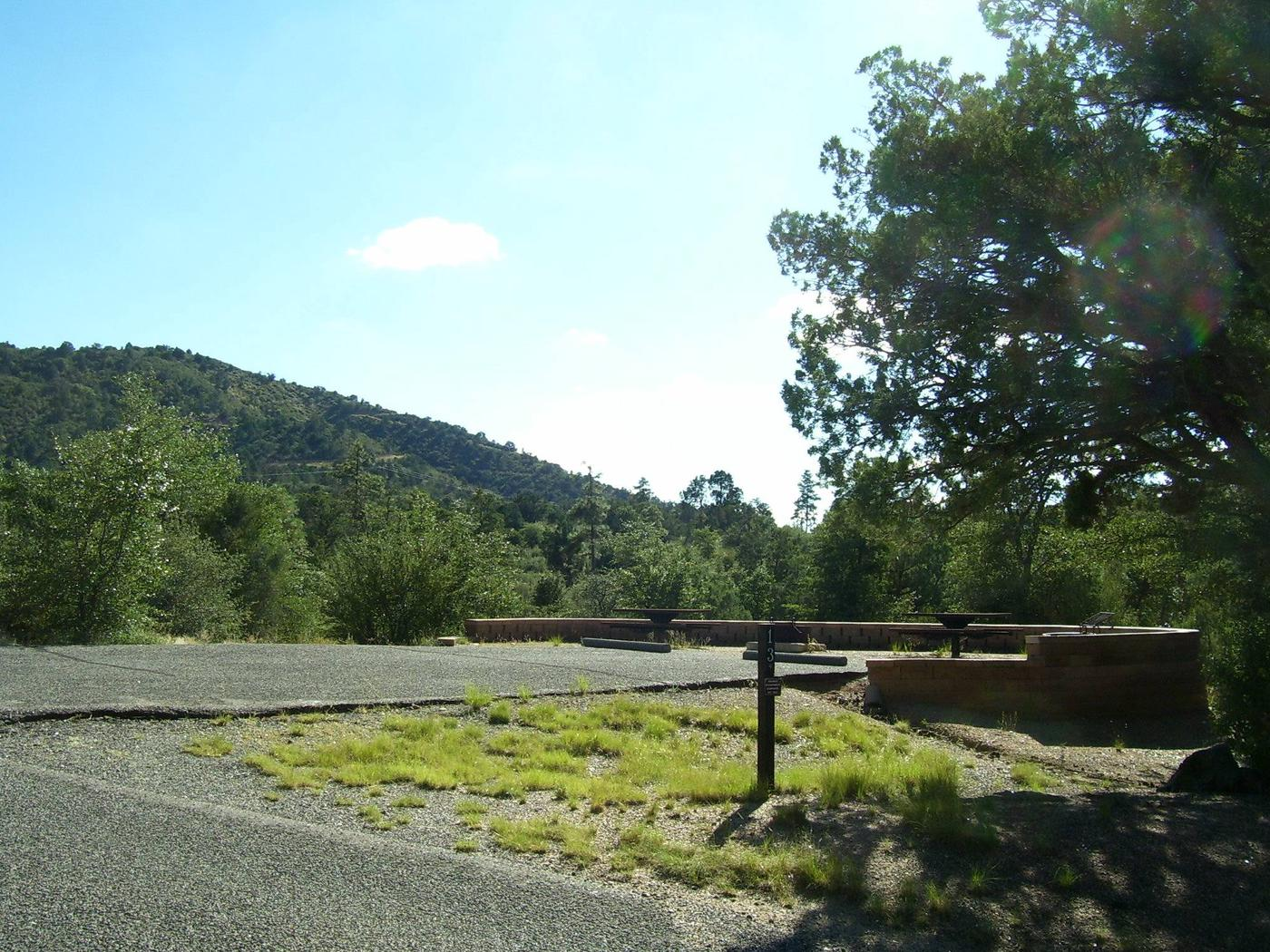 Double Site #13 with double parking, two tables and block retaining wall with no shade at the tables.Double Site #13 Yavapai Campground