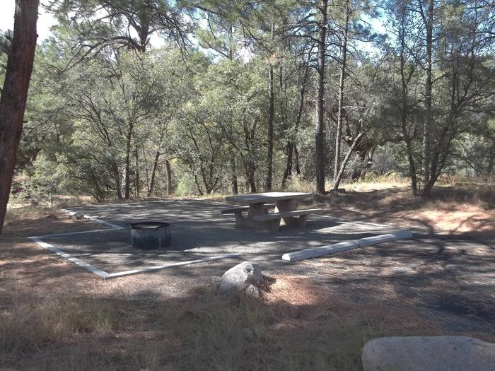 White Spar Site 1 gravel tent pad and picnic area lined with concrete edging. Heavily shadedWhite Spar Site 1