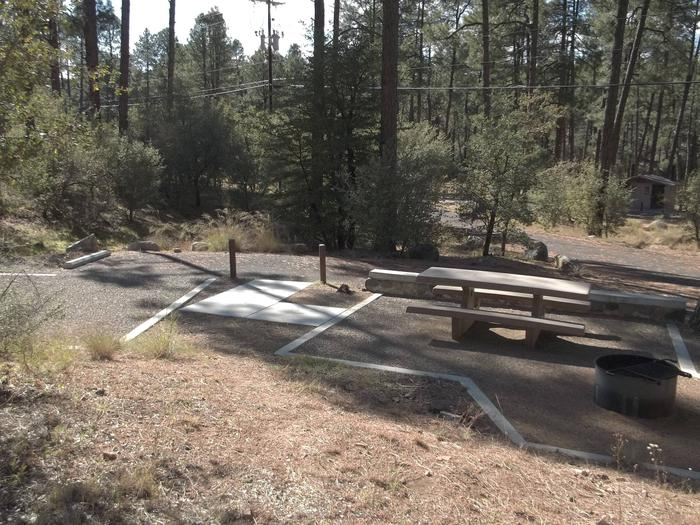 Accessible Site 30 with short sidewalk from paved parking to shaded graveled picnic area to the right and tent area to the left.White Spar Site 30