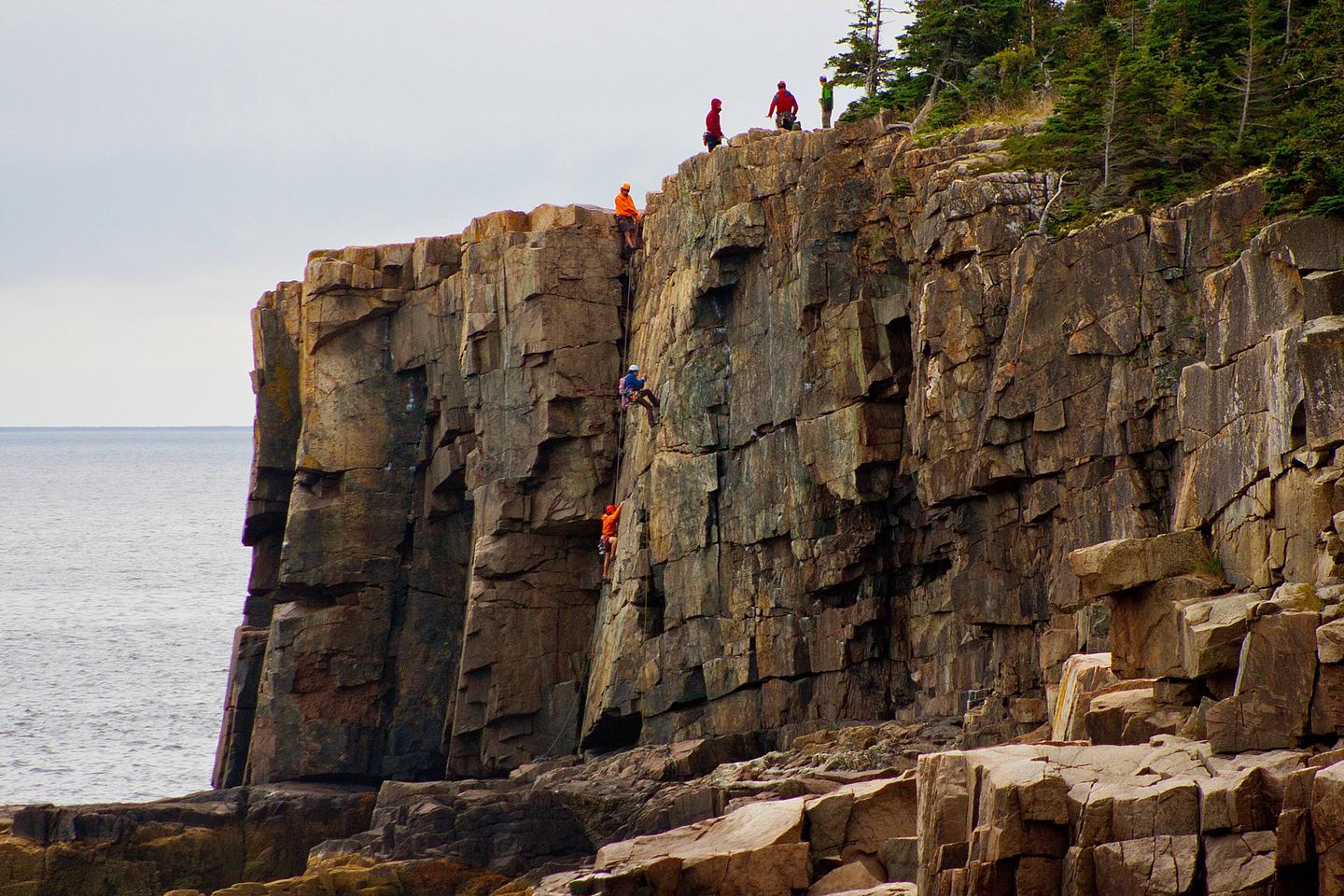 Climbers ascend Otter Cliffs at Acadia National ParkClimbers ascend Otter Cliffs at Acadia National Park.