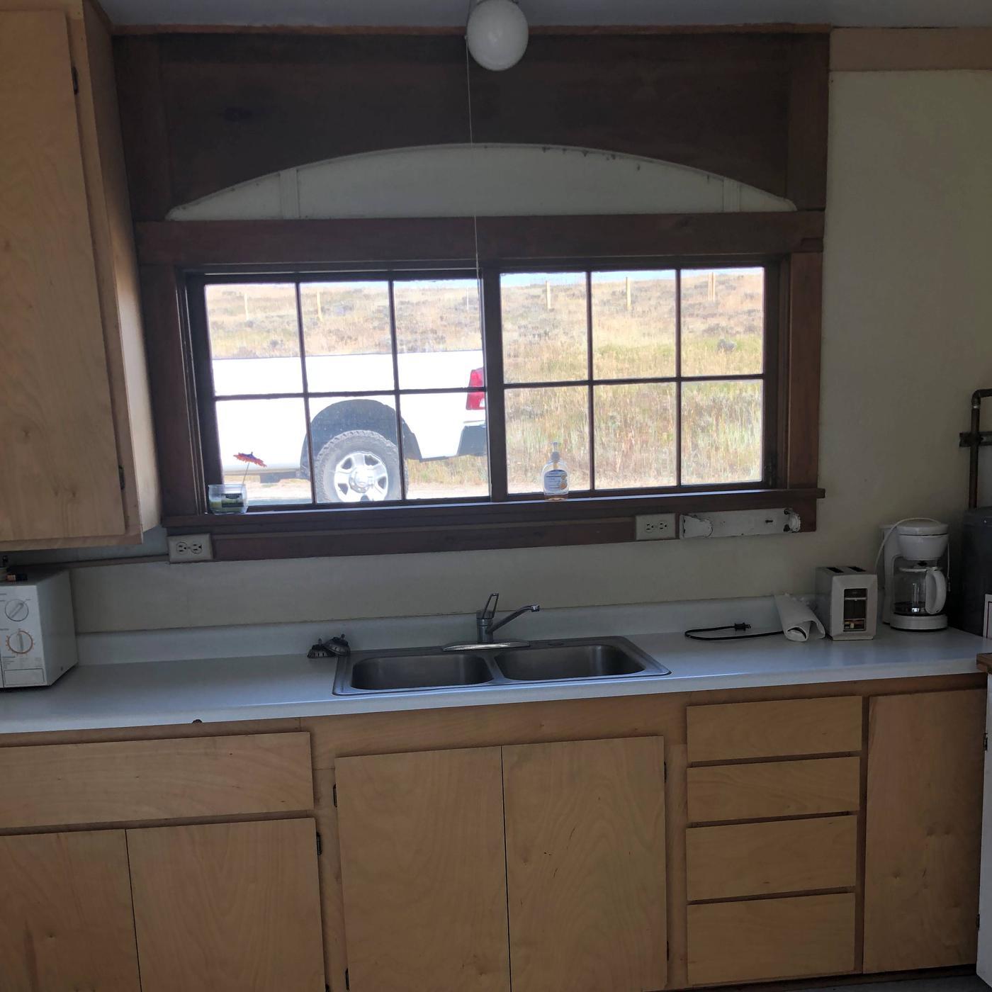 Kitchen WindowKitchen window looks to the north, coffee pot, can opener, micro wave