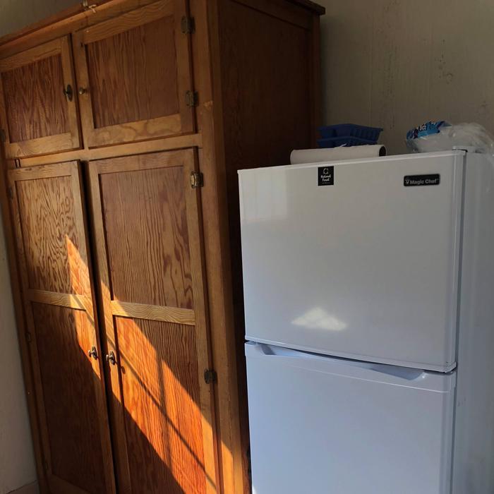 FridgeKitchen fridge and storage closest
