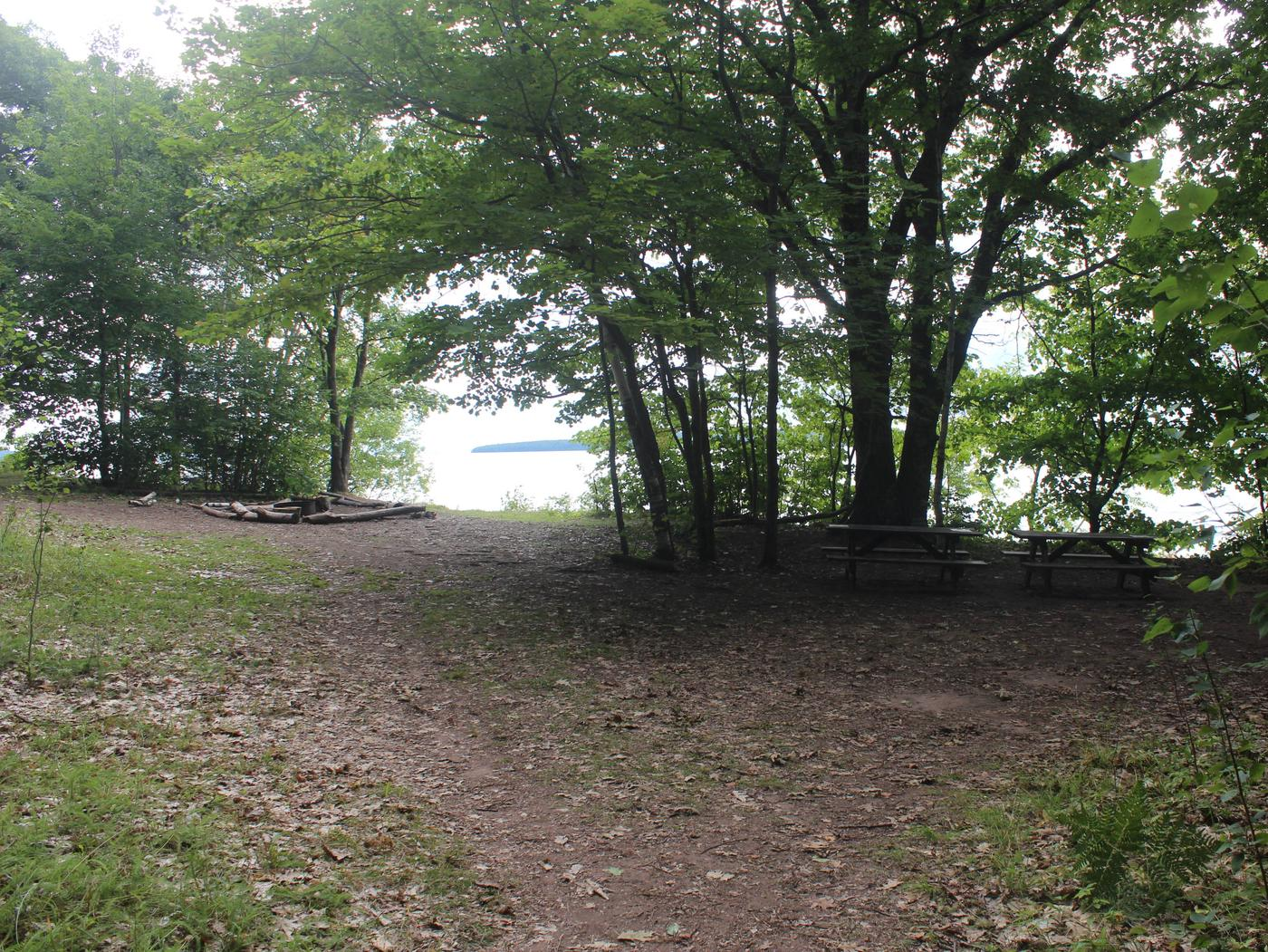 Oak site A with fire ring, two picnic tables, and lake viewOak site A