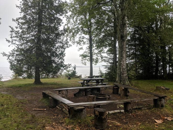 Sand site B with two picnic tables, fire ring, and lake viewSand site B