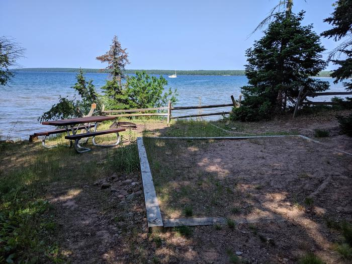 Stockton site 2 with picnic table, fire ring, tent pad, and lake viewStockton site 2