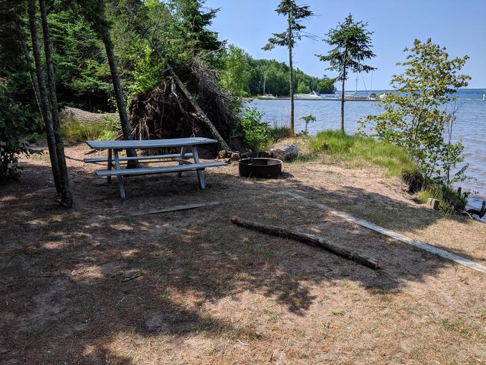 Stockton site 4 with picnic table, fire ring, tent pad, and a lake viewStockton site 4