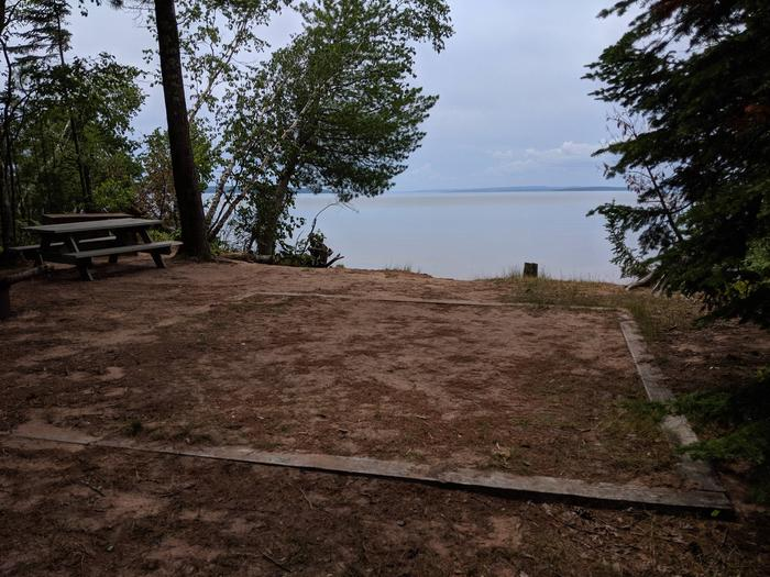 Stockton site 5 with picnic table, tent pad, and lake viewStockton site 5