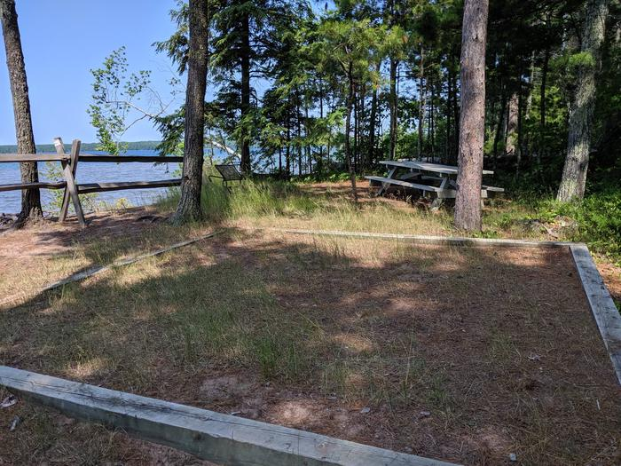Stockton site 7 with picnic table, tent pad, and lake viewStockton site 7