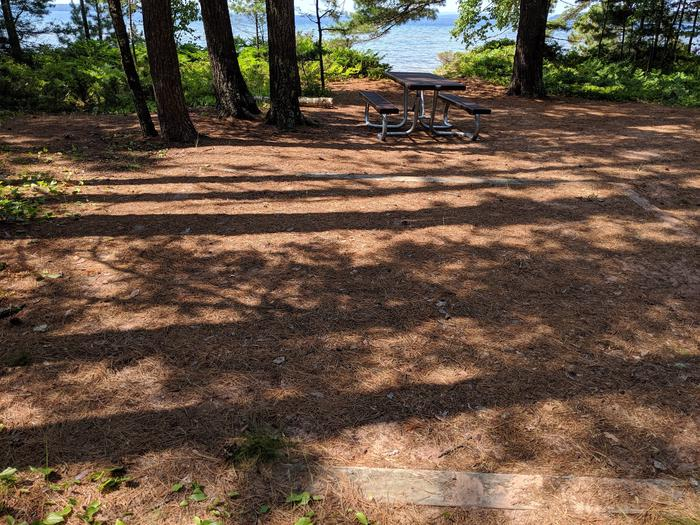 Stockton site 18 with picnic table, tent pad, and lake viewStockton site 18