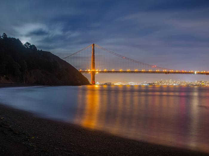 A view of the bay from Kirby Cove, with the Golden Gate Bridge lit.Kirby Cove offers beach access with a view of the Golden Gate Bridge.