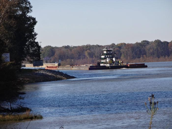 Just a little bit of barge traffic on the Tombigbee River.Barge on the move.