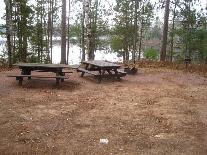 Lake view from site 8Site 8 offers one of the best views of the lake, and as a double site there are two picnic tables, a grill, and a fire pit for campers to enjoy.